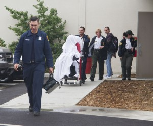 Pierce College women's volleyball player Azeezat Anthonio was carried out on a gurney by LAFD paramedics from the South Gym on Oct. 9 after a possible seizure, according to Sheriff's Deputy Al Guerrero. She hid under a sheet to hide her identity.