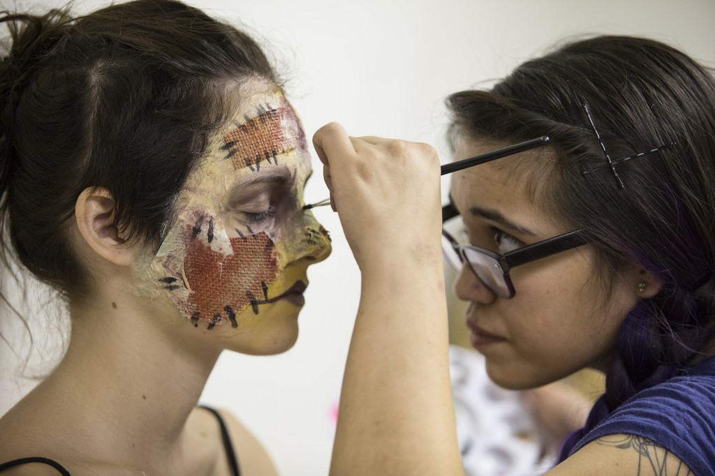 Michelle De La Cruz applies burlap, latex, tissue paper, and make up on scare actor Lea Moore for the grand opening of the 10th Harvest Festival at the Pierce Farm Center on Sept. 26, 2014.Photo: Diego Barajas