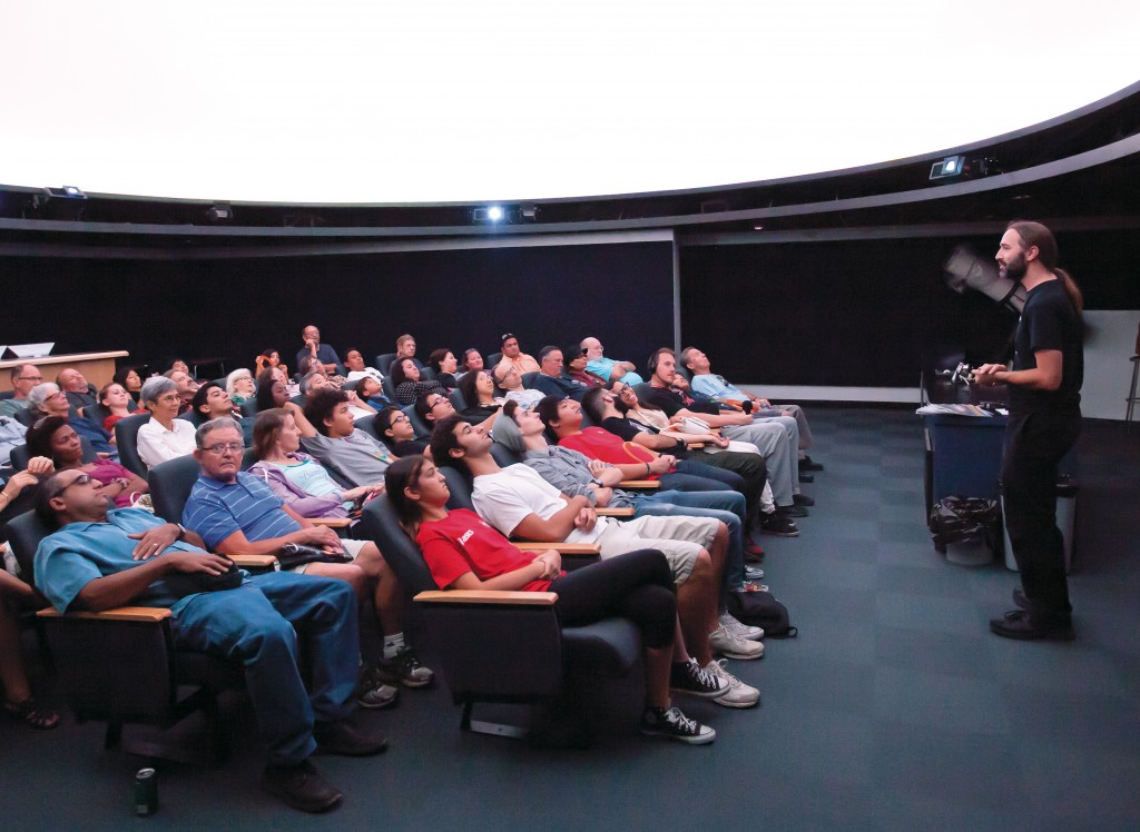 Dale Fields, Associate Professor of Astronomy, introduces the Planetarium to some of the attendees of the Science, Imaging & Astronomy (SIA) Expo on Saturday Oct. 11, 2014 at the Center for Sciences Building. Woodland Hills, Calif. Photo: Mohammad Djauhari
