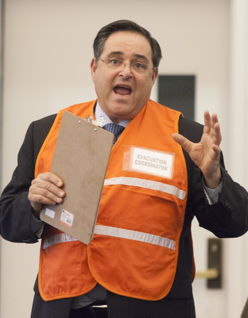 Pierce College Associate President Larry Kraus displays the  new evacuation cordinator vest at the Academic Senate meeting that will be given to selected people in in different buildings on campus incase of an evacuation on Monday  Dec. 1, 2014. Photo: Diego Barajas