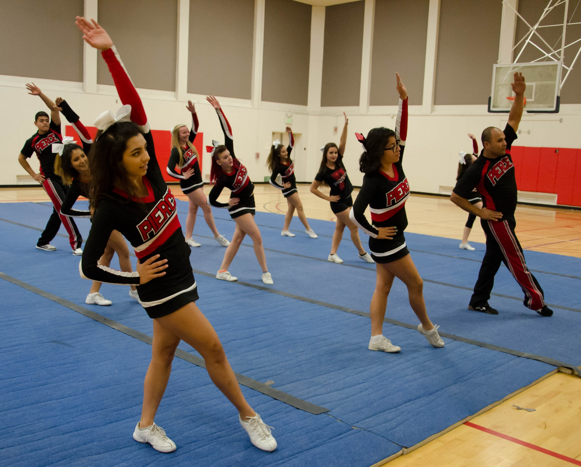 PHOTO ESSAY: Cheer Competition Team train for upcoming tournament