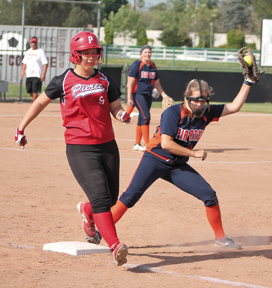 Alicia Augustinus makes it to first base. On the Softball Field at Pierce College Woodland Hills Calif. Monday, March 16, 2015. Photo By Tim Daoud
