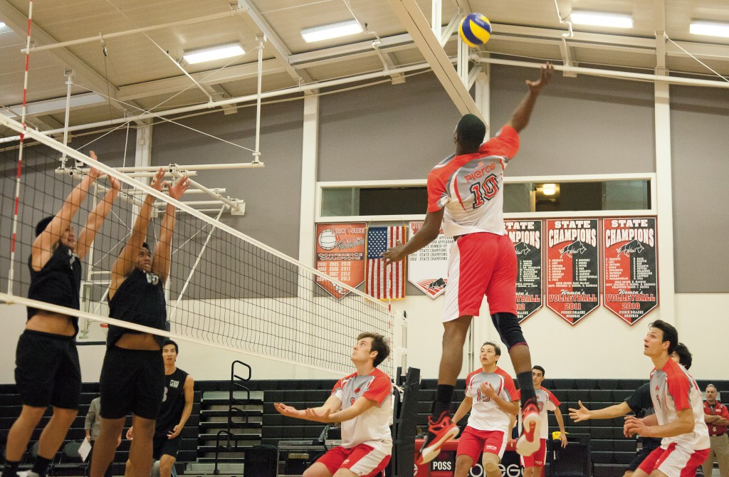 Corey Pitt spikes the ball during a home game against Golden West College on Wednesday, Feb. 18, 2015. Photo: Mohammad Djauhari