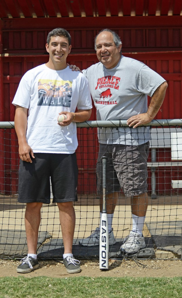 Pierce baseball pitcher, Adam Ramirez, poses for a portrait with his father, Athletic Trainer, Lenny Ramirez in the home dugout at Joe Kelly Field located at Pierce College in Woodland Hills, Calif. on April 30, 2015. Photo by: Skylar Lester