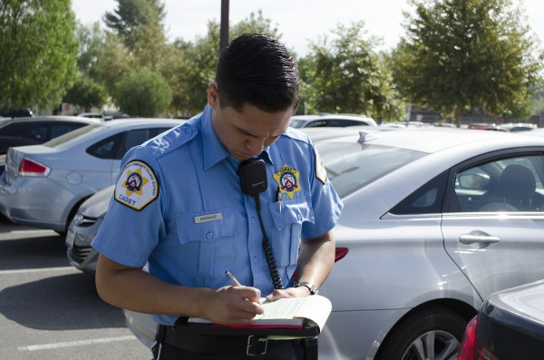 Cadet Andrade of the Los Angeles Community College District of the Los Angeles Sheirff's Department, writes a ticket for vehical without a parking permit in Parkting Lot 2 on Sept. 14th, 2015 at Pierce College Woodland Hills, Cali. Today is the first day of parkting permit enforcemnet. Photo by: Christopher Mulrooney