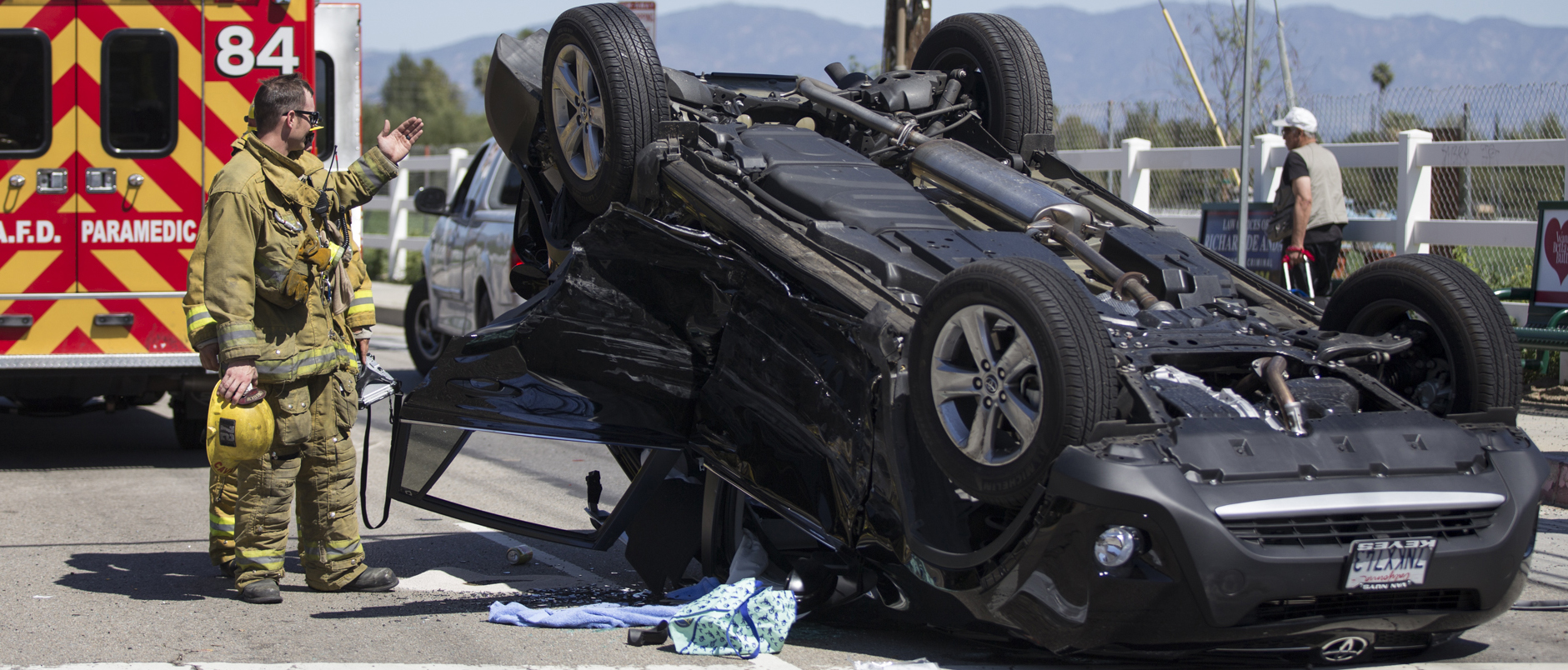 Car overturns in collision on De Soto Avenue
