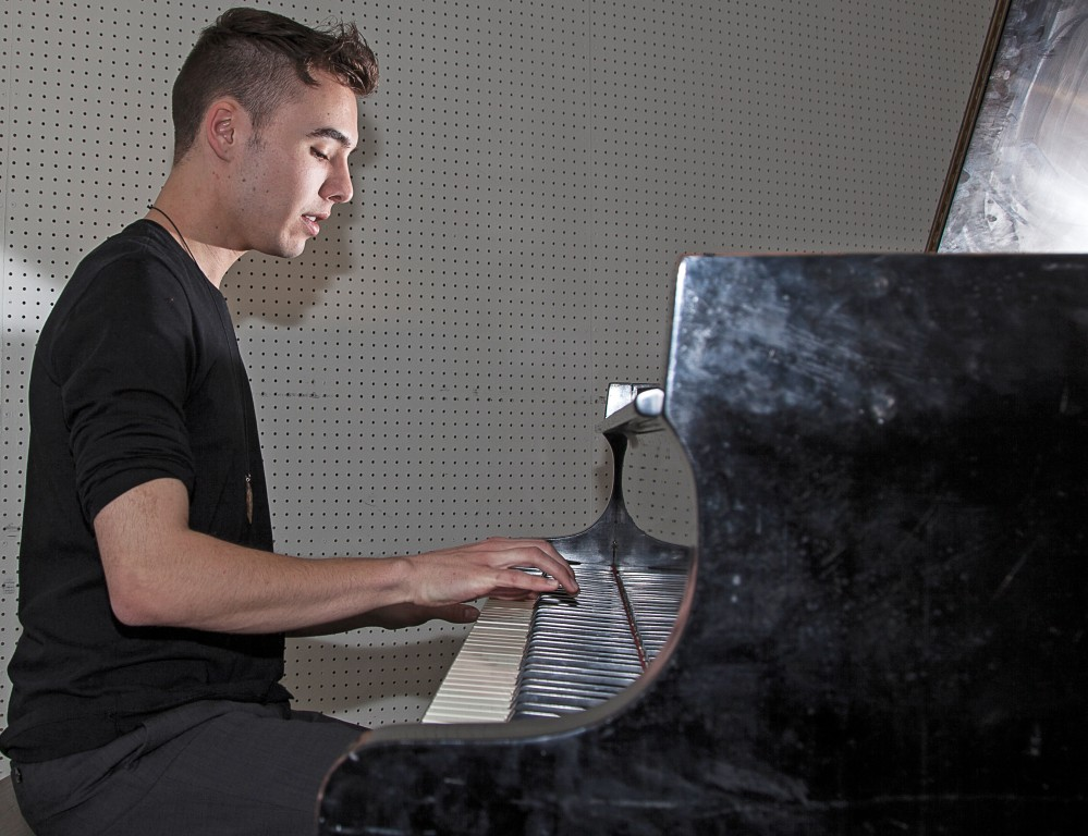 """22-year-old Evan Henzi, a ethnomusicology major, plays his original score """"Alien,"""" on a piano inside one of the music rooms of the Music Center at Pierce College in Woodland Hills, Calif. on Wednesday, March 30, 2016. Photo: Mohammad Djauhari"""