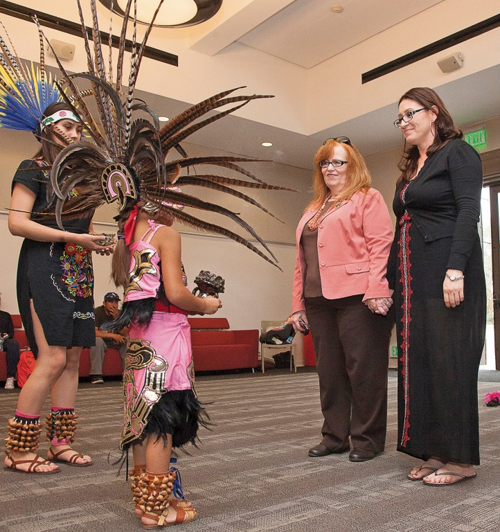 Vallerie Flores prepares to bless Pierce College President Kathleen Burke, center left, and Angelita Rovero, professor of Chicano Studies, center right, in an Aztec ritual during the 1st Annual Cinco de Mayo Celebration inside The Great Hall in Woodland Hills, Calif. on Thursday, May 5, 2016. The event also celebrates the approval of the additional Chicano Studies classes coming to Pierce. Photo: Mohammad Djauhari