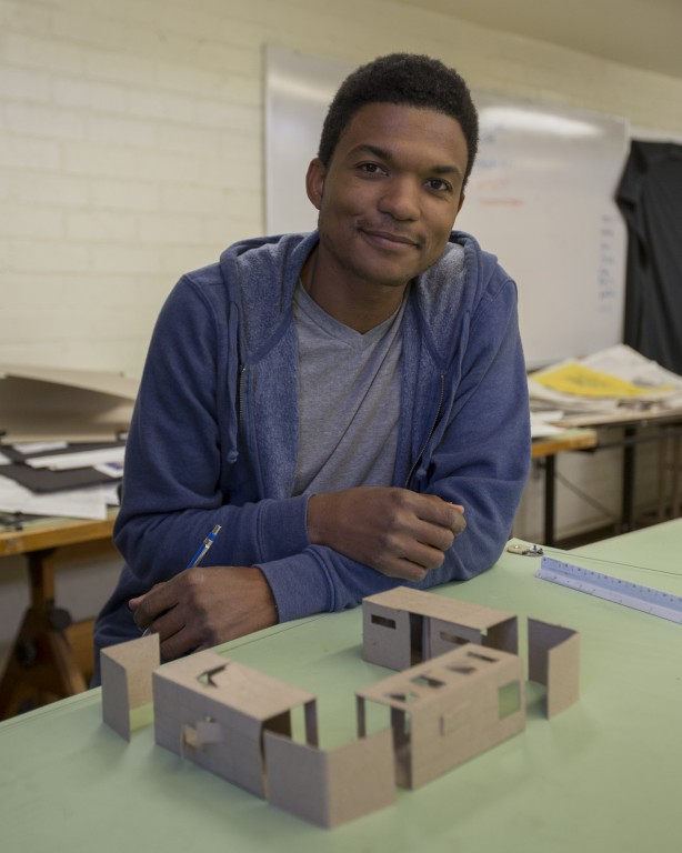 Rudy McCollum poses with his model container homes in the architecture studio on Thursday, April 28, 2016 at Pierce College in Woodland Hills,Calif. This model is designed for a single mother with a teenage child and a baby, inspired by Japanese homes. Photo: Travis Wesley