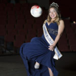 Jenny Godoy Lopez, winner of the 2015-2016 Reina Amigas Sensuntepecanas Los Angeles California, sits on the stage of the Performing Arts Building for a portrait on Sept. 15, 2016.  The soccer ball  is an example of what she handed out to children through her humanitarian work. At Pierce College in Woodland Hills, Calif. Photo by Taylor Arthur