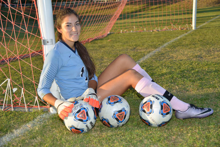 Goalie Brianna Jacobo poses with soccer balls at The Pit on Oct. 4, 2016 at Pierce College in Woodland Hills, Calif.