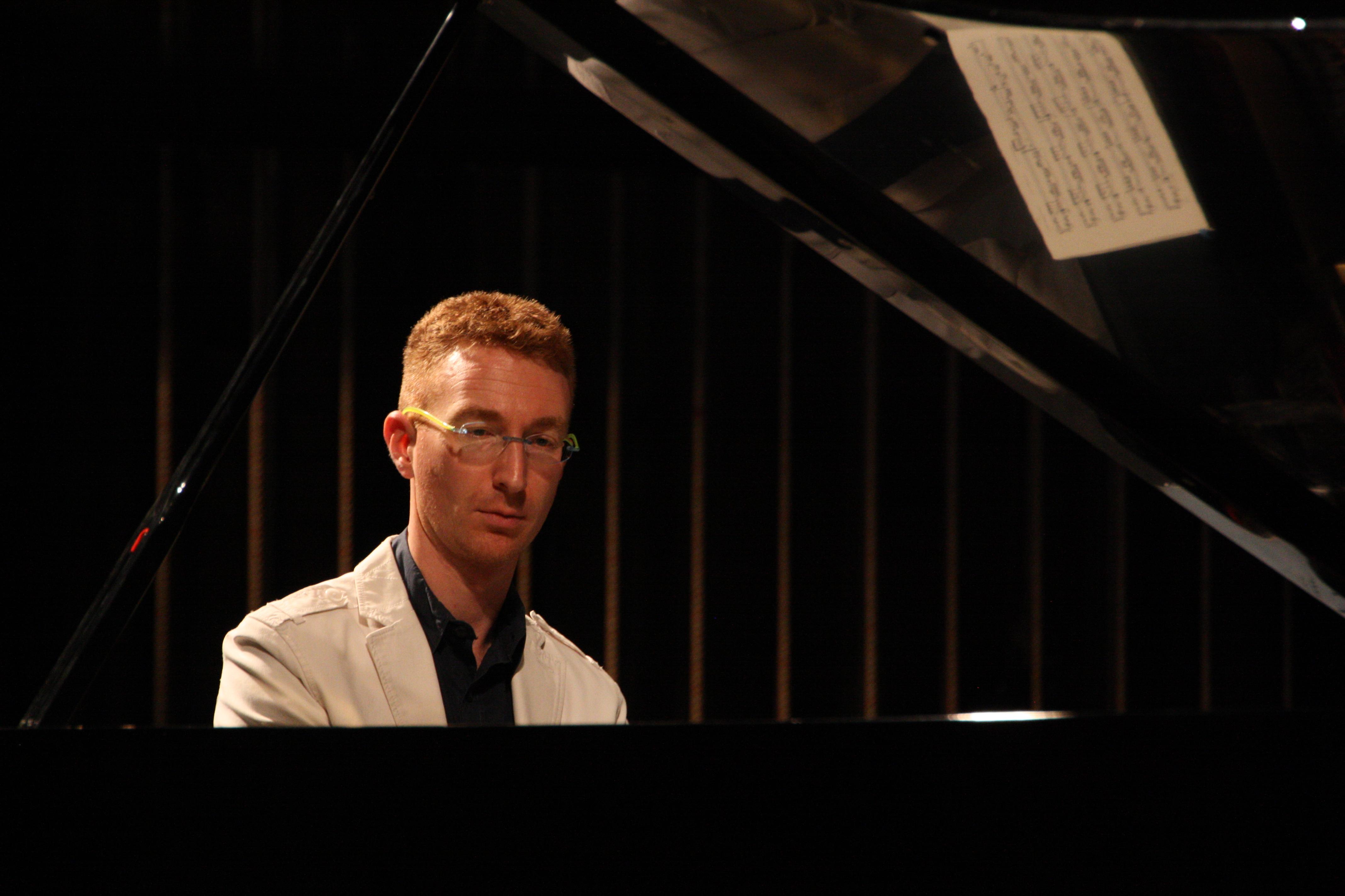 Piano professor tips the scales