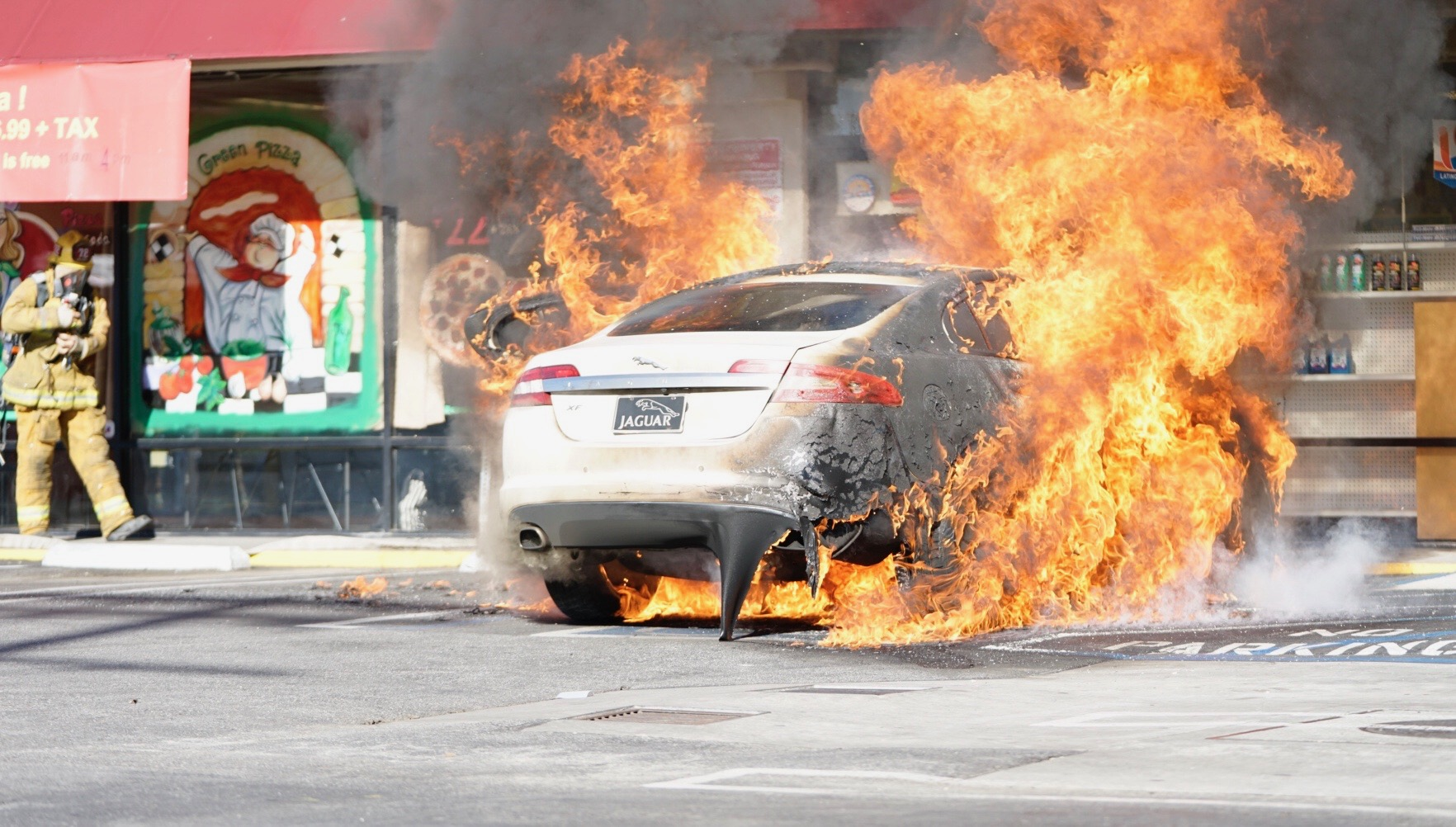 Fire BBQ's car in shopping plaza