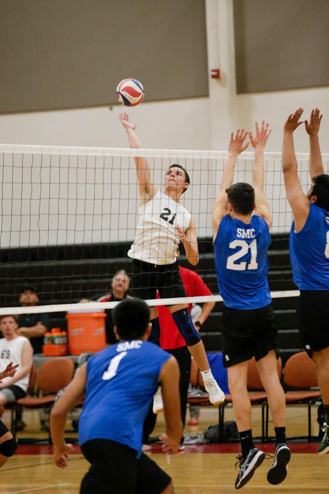 Men's volleyball win home opener
